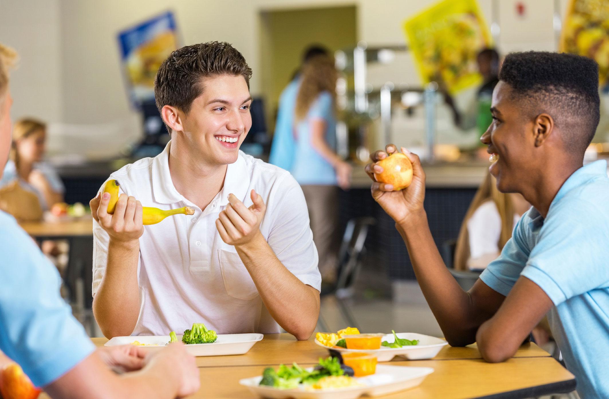 HS-Boys-enjoying-lunch