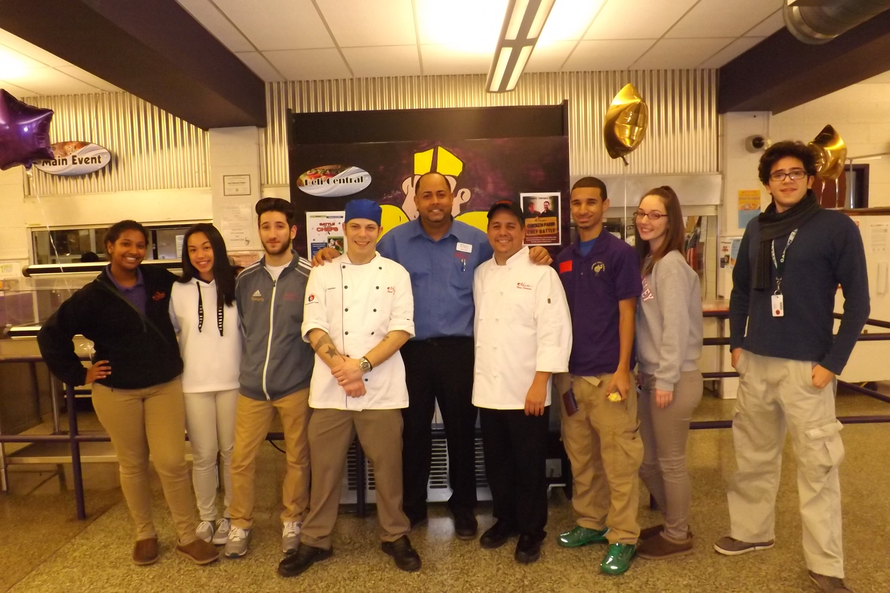 Corporate Chef Michael Herman, Area Supervisor Kevin Dyal, and Garfield Chef Steve Escobedo pictured with students from Garfield High School